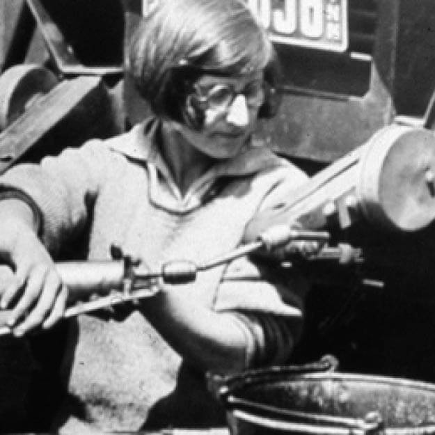 1920s black and white photo of a woman working with equipment