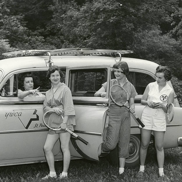 1950s photo of girls getting out of a car with tennis rackets