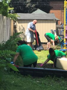 Volunteers working to clean up playground