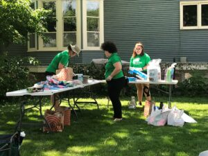 volunteers assembling birthday party kits