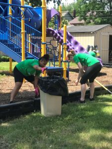 volunteers cleaning up playground