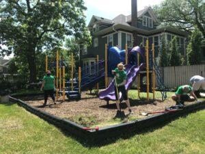 volunteers weeding playground