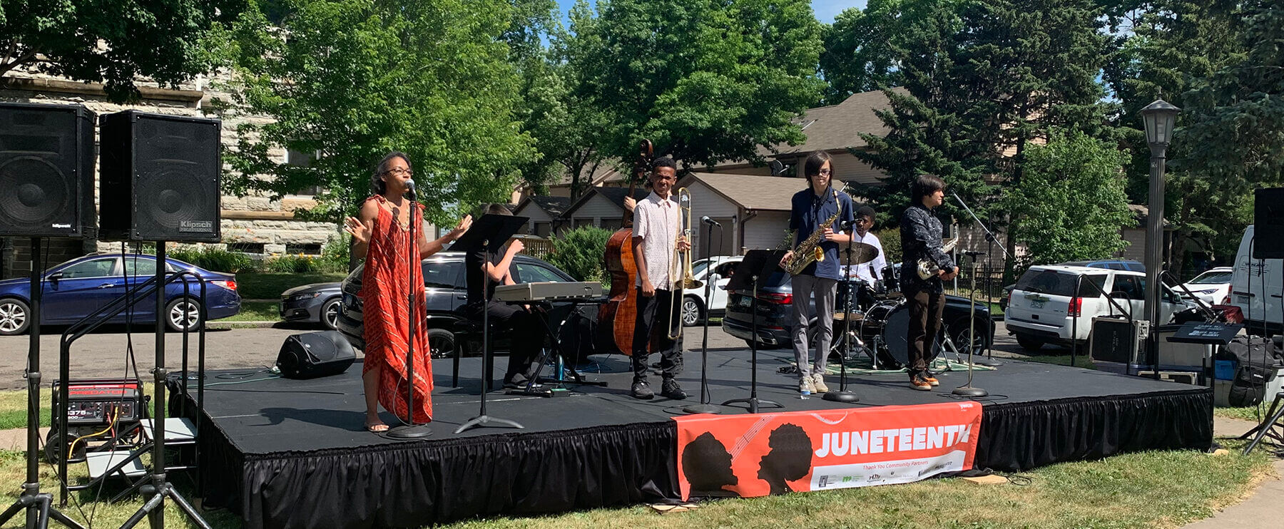 musicians on stage at Juneteenth event