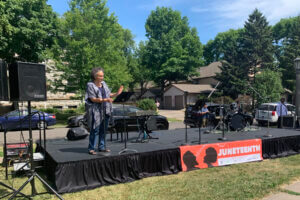 Gaye Adams Massey speaking to crowd at Juneteenth Event