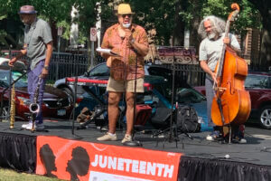 close up of musicians on stage at Juneteenth event